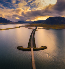 Wall Mural - Aerial view of an iconic bridge in west Iceland at sunset