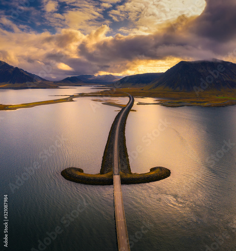 Wall mural Aerial view of an iconic bridge in west Iceland at sunset