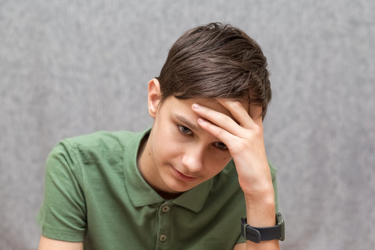 teenager boy is thoughtful and sad