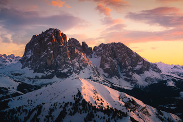 Wall Mural - Dolomites, Italy. Sassolungo and Sassopiatto mountains during sunset in winter season.