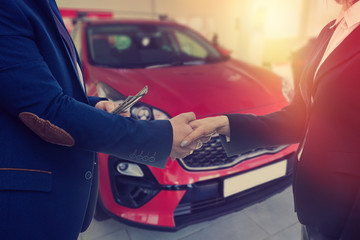 Buying a new car. The buyer and seller enter into an agreement to buy or lease a car