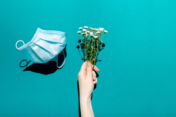 Medical blue mask with flowers. Creative concept of seasonal flu and allergies. Fototapete