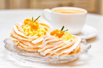 Meringue cake decorated with kumquat and coffee