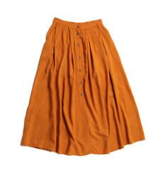 Elegant long orange skirt isolated on white, top view