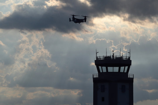 Jacksonville, NC / USA: Military Osprey flies over OAJ airport