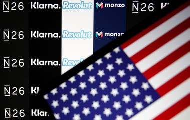 The N26, Monzo, Revolut and Klarna logos are displayed behind a U.S. flag in this illustration