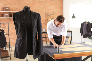 Mannequin with half-finished male suit in tailor's workshop