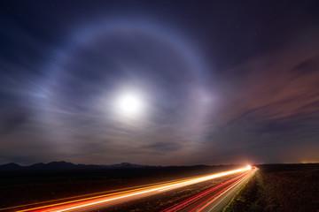 Moon halo in the night sky