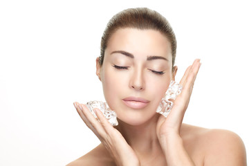 Spa Woman with healthy clean skin applies ice cubes on face. Cold Beauty Treatments
