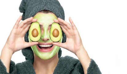 Happy young woman with avocado facial mask