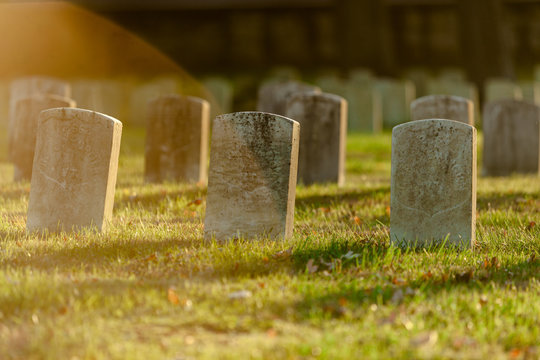 Tombstones in warm Evening Light an Antietam National Cemetery in Sharpsburg, Maryland, USA - with Copy Space
