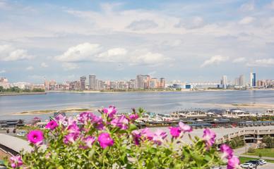 View of the bank of Kazanka through flowers in Kazan