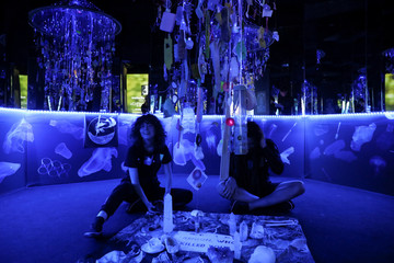 Models conduct a seance while presenting creations during the Zero Waste Daniel immersive fashion show at Arcadia Earth in the Manhattan borough of New York City