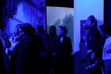 People explore the Zero Waste Daniel immersive fashion show at Arcadia Earth in the Manhattan borough of New York City