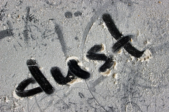 A dusty surface with the word dust written on it.