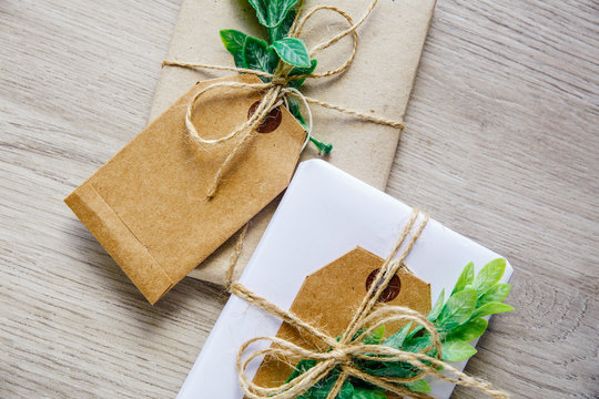 Natural style handcrafted gift boxes with rustic hemp cord.
