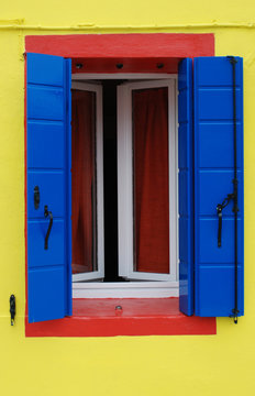 Window painted yellow, blue, red