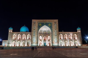 View of Registan square in Samarkand - the main square with Ulugbek madrasah at night. Uzbekistan