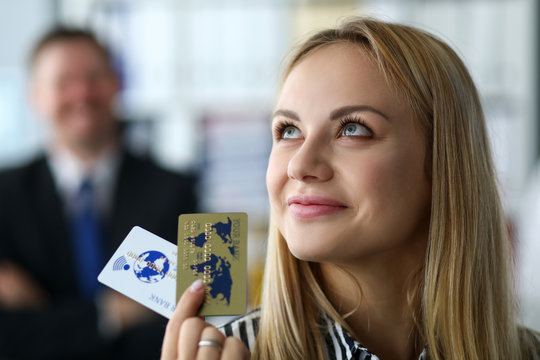 Manager restores solvency company or enterprise. Specialist is proud her achievements, girl is holding golden bank cards in her hands. Assistance to top managers business management enterprises.