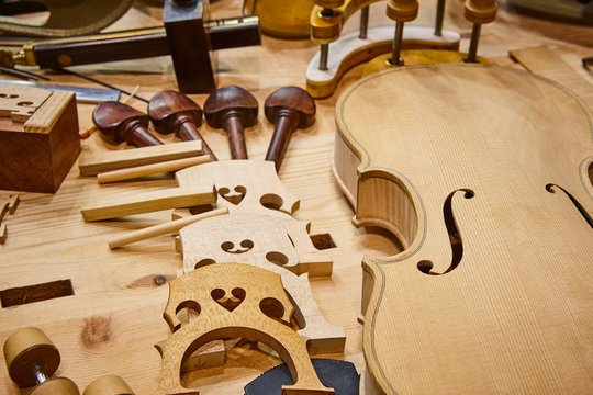 Luthier workshop with violin parts and tools. Traditional craftmanship.