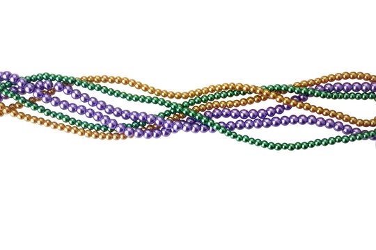 Three colors mardi gras beads for decoration isolated ob white background
