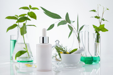 Set of cosmetic products standing in laboratory  on white background.