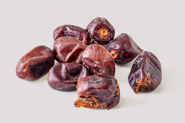 Dried dates on a light grey background
