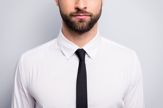 Cropped closeup photo of handsome business man hiding half face not smiling serious worker wear white office shirt black tie isolated grey color background