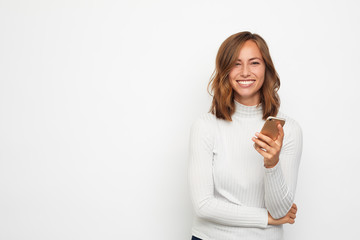 Fototapeta portrait of young beautyful woman on the phone looks in camera obraz