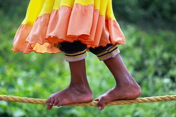 Girl on tight rope walking. Kumbh Mela at Nasik.