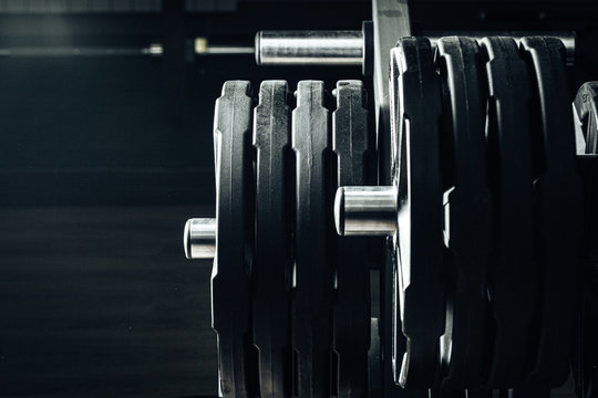 Gym weight plates on holder close up