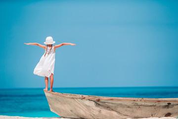 Poster Zanzibar Happy little girl walking at beach during caribbean vacation