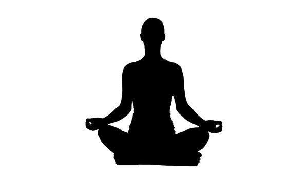 silhouette of woman in lotus position