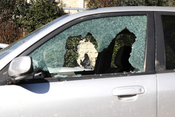 The window of a car damaged during a suspected Palestinian shooting attack in which an Israeli policeman was injured lightly is seen near the scene in Jerusalem's Old City