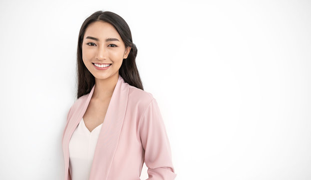 Portrait of smiling confident asian business woman in pink suit office. Asian business girl standing. Startup successful business executive people looking at camera with copy space isolated on white
