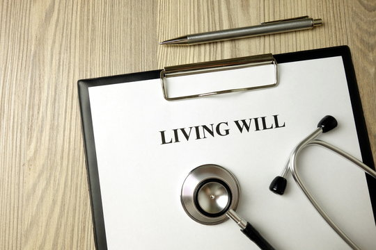 Living will directive with stethoscope and pen