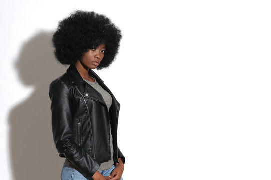 High fashion afro-american model in black leather jacket.