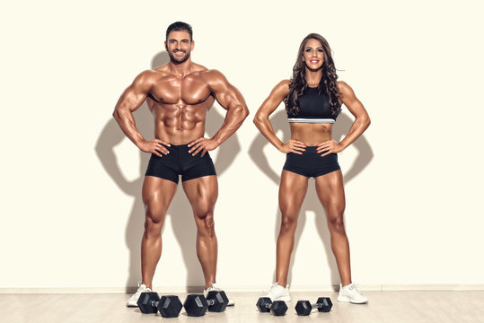 Fitness Couple Exercising Together With Weights