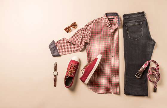 Men's casual fashion outfit - jeans, plaid shirt and red sneakers