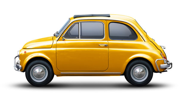 Small retro car of yellow color, side view isolated on a white background.