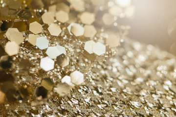 Abstract gold background with copy space. Golden holiday glowing abstract glitter defocused...