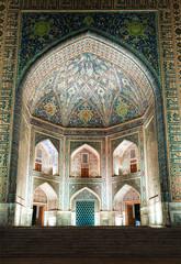 Registan square in Samarkand, Tillya-Kari madrasah (17th century). The fragment of main entrance portal. Uzbekistan