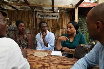 Vegans are seen gathered at a vegan restaurant in Lagos