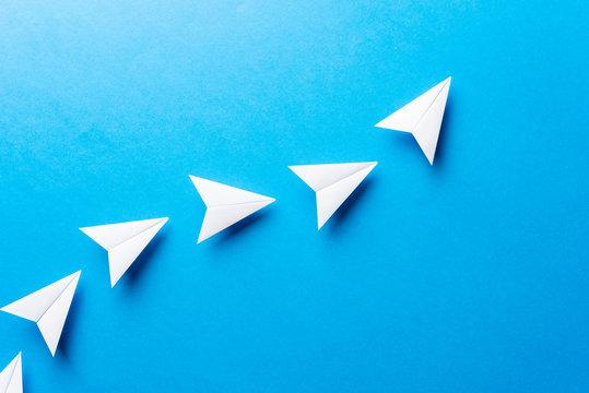 Progress concept. Agile development attainment, motivation, growth concept. Business concept of goals, success, achievement and challenge. White paper airplanes on blue background.