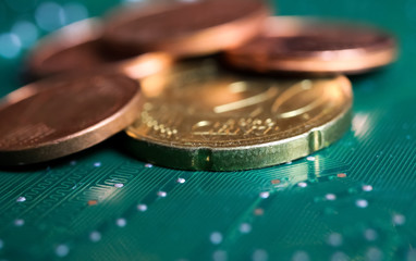Makro close up of isolated blurred pile euro cent coins on green motherboard