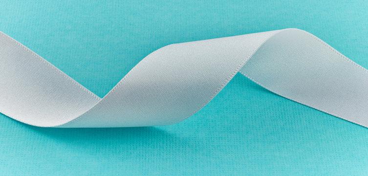 White Ribbon on Tiffany Blue Background