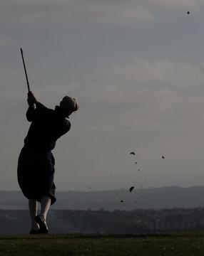 A competitor plays a shot during the Scottish Hickory Golf Tour at Braid Hills Edinburgh, Scotland
