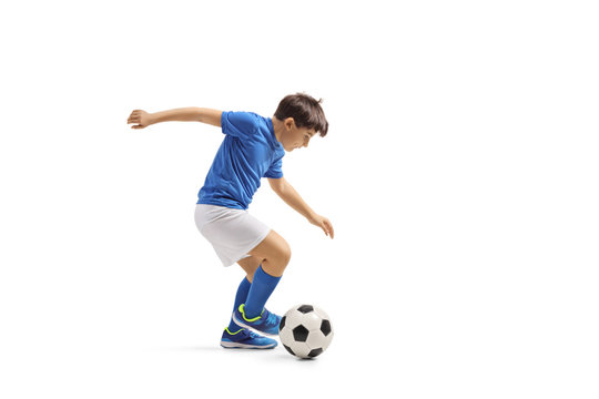 Boy in a blue jersey playing football