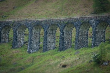 Detail of the stone arches of the railway bridge at Crianlarich, Scotland. Concept: Scottish railways, mysterious ancient places, Scottish nature
