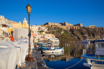 Procida (Italy) - .View of Corricella bay in the sunset light, a romantic village of fishermen in Procida, Italy